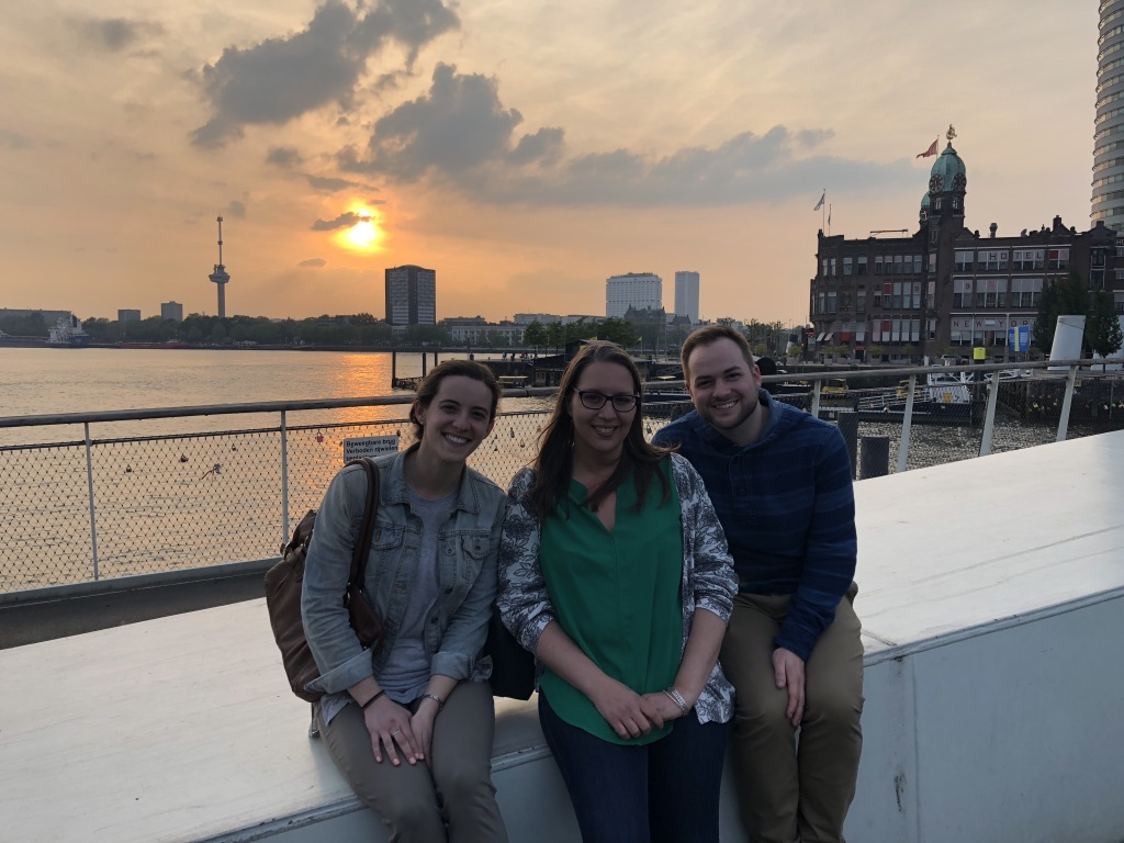 Dr. Russo and CARE Lab graduate students smiling in Rotterdam at the annual INSAR Conference.